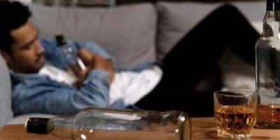 bigstock Drunk Man Sleeping On Sofa And 288295024 900x450 1