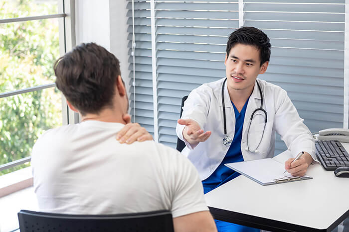 athlete patient having consultation with doctor