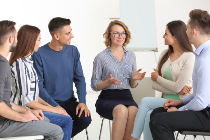 psychologist and patients at group psychotherapy session
