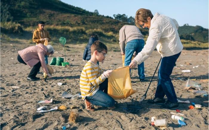 volunteers cleaning the beach